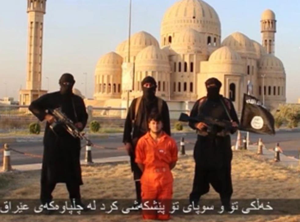 Isis has released a video apparently showing the beheading of a Kurdish man in Iraq as a warning to Kurds fighting the group in Iraq