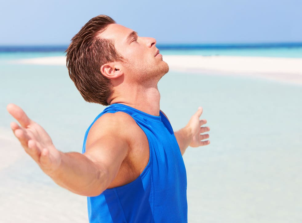 A man meditates on a beautiful beach - but would he better off just practicing Buddhism?