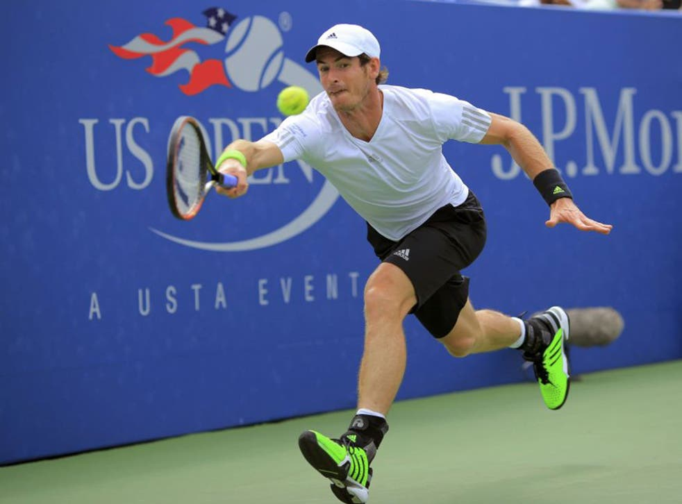 Andy Murray hits a return during his win over Andrey Kuznetsov