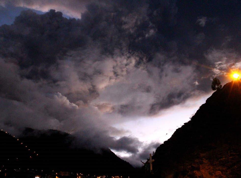 The Tungurahua volcano erupting is seen from Banos, Ecuador on April 4, 2014