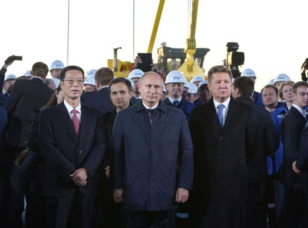 From left to right: Chinese vice-premier Gaoli, Russian president Putin and Gazprom CEO Alexei Miller