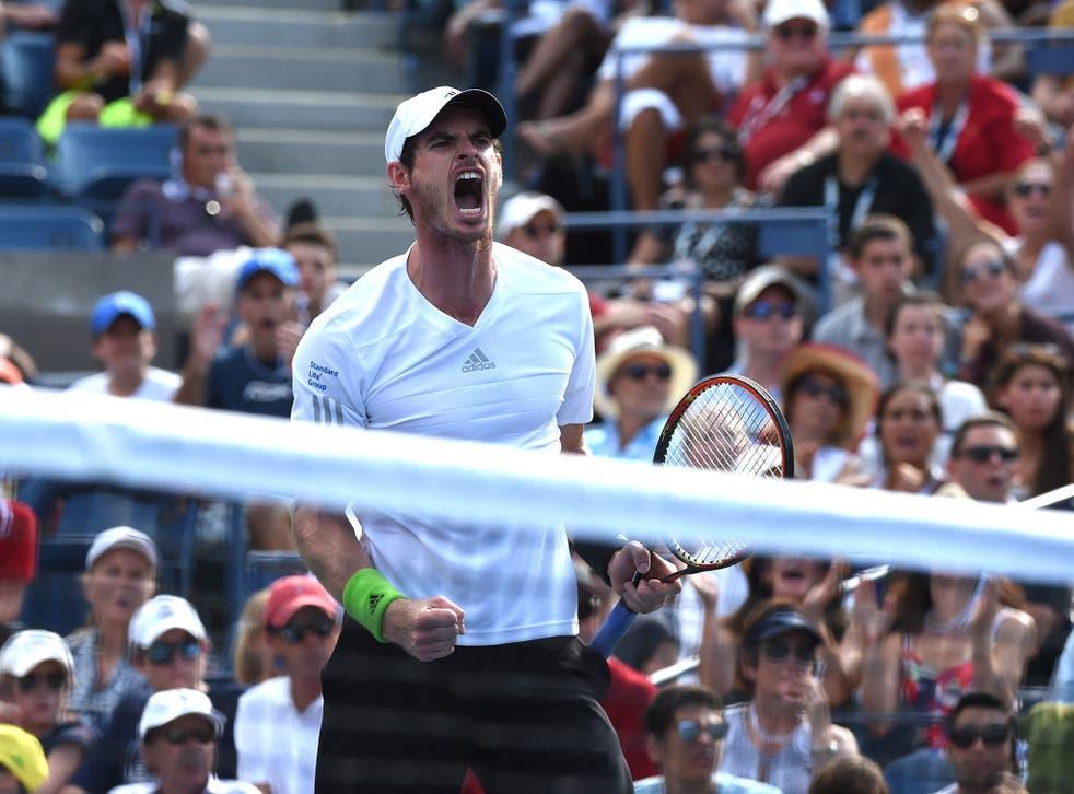 Andy Murray celebrates a shot while playing Jo-Wilfried Tsonga
