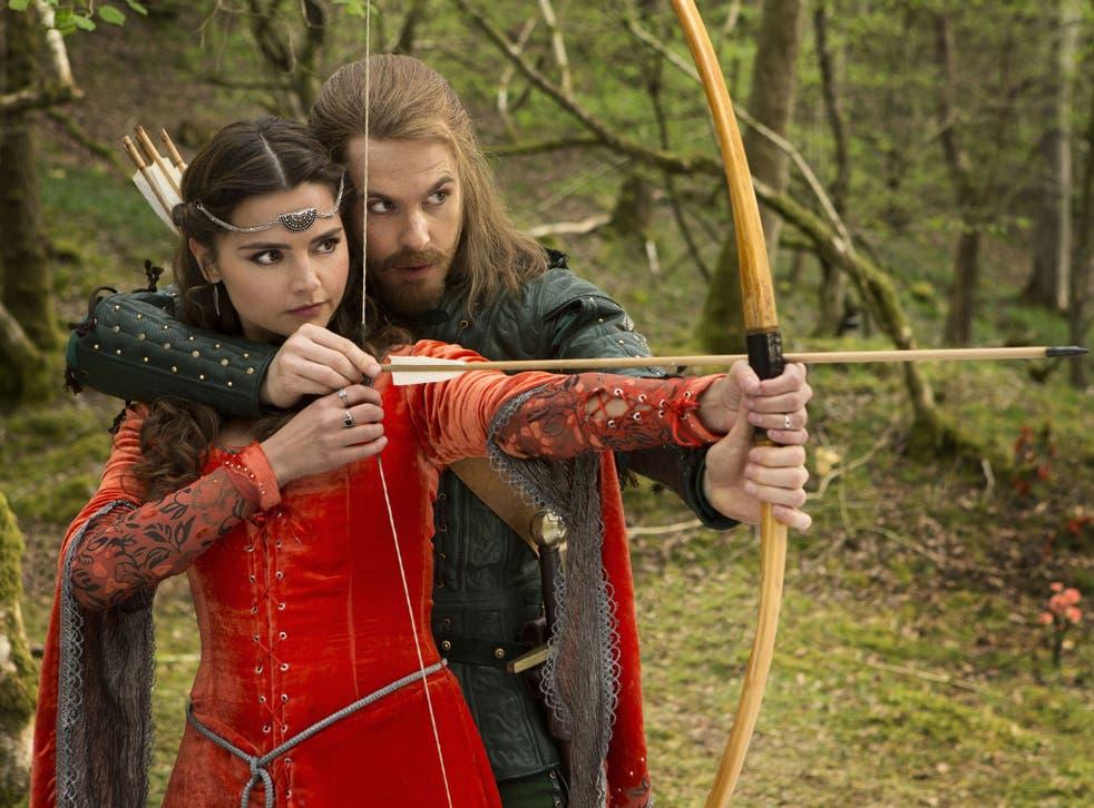 Robin teaches Clara to shoot an arrow
