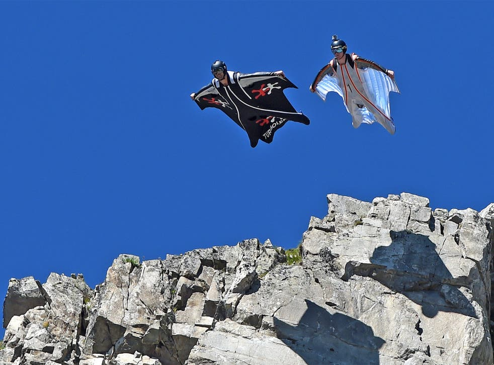 Two men jump from the top of the Brevent mountain to fly in wingsuit over the French ski resort of Chamonix, earlier this year