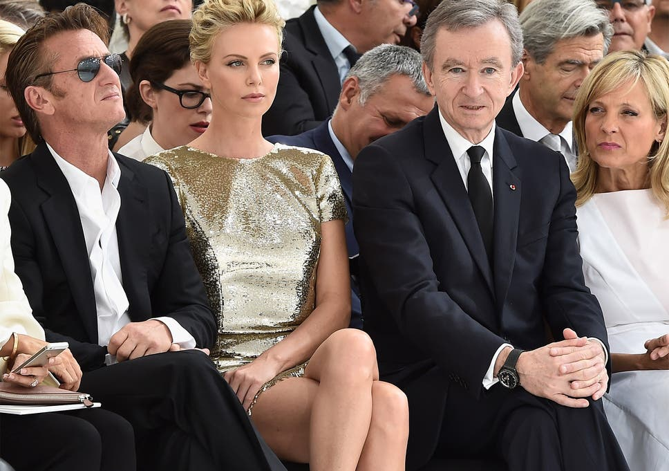 Actors Sean Penn (left) and Charlize Theron joined Bernard Arnault and wife Helene at this year's Paris Fashion Week
