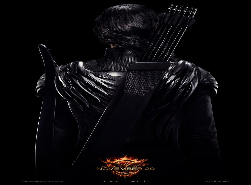 Jennifer Lawrence resembles the Dark Knight in this dark and menacing Hunger Games photo