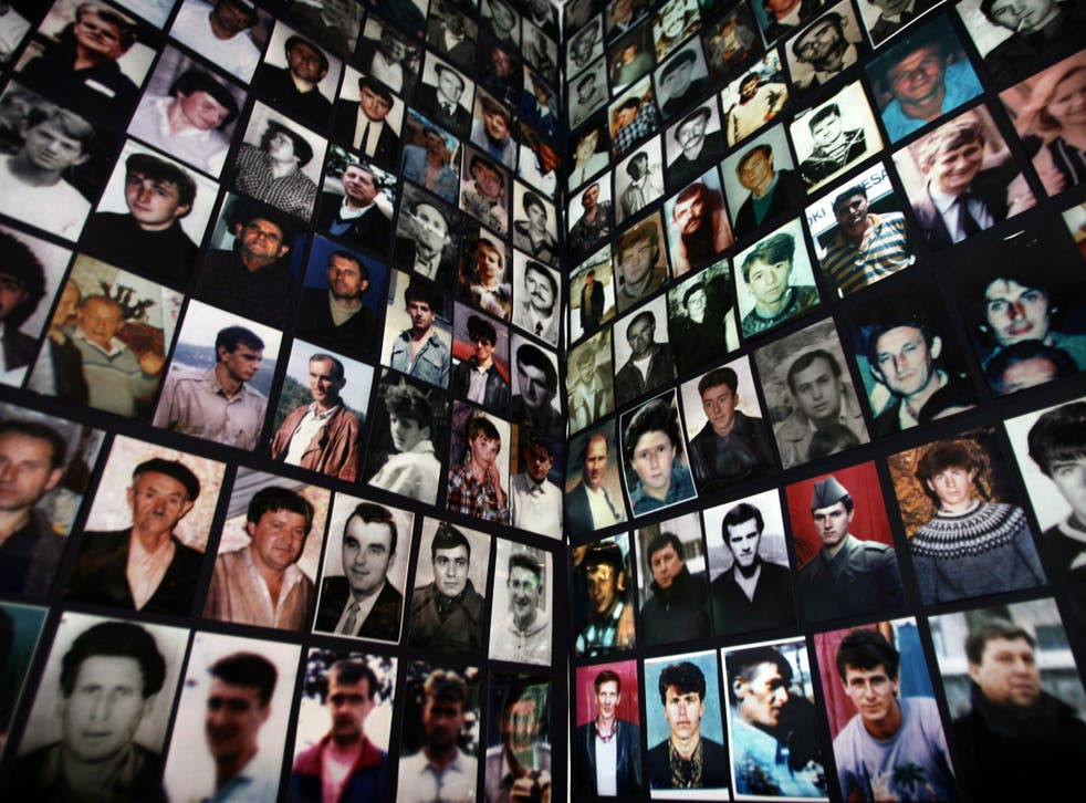 Portraits of victims of the 1995 Srebrenica massacre collected for a memorial in the Bosnian town of Tuzla