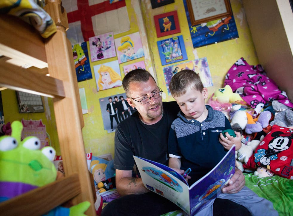 Damien (39) reads to Lucas (5) at home in Sheffield. The family is involved in the FAST  (Families and Schools Together) programme which encourages parents to read to their children at home
