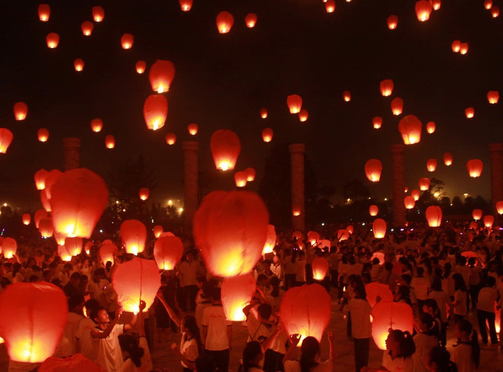 Many festival-goers will fly floating lanterns during the event in the belief it can ward off bad luck.