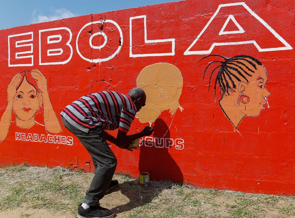 A Liberian man paints on a wall as part of a sensitization programme about the deadly Ebola virus in Monrovia, Liberia. The World Health Organization (WHO) has said the number of deaths from Ebola has risen to 2100 in West Africa with an exponential surge