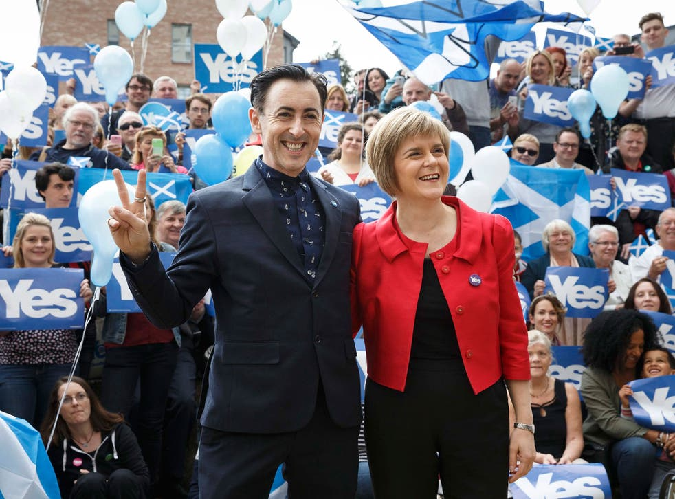 Deputy First Minister of Scotland Nicola Sturgeon and actor Alan Cumming outside the Yes Kelvin campaign hub in Glasgow