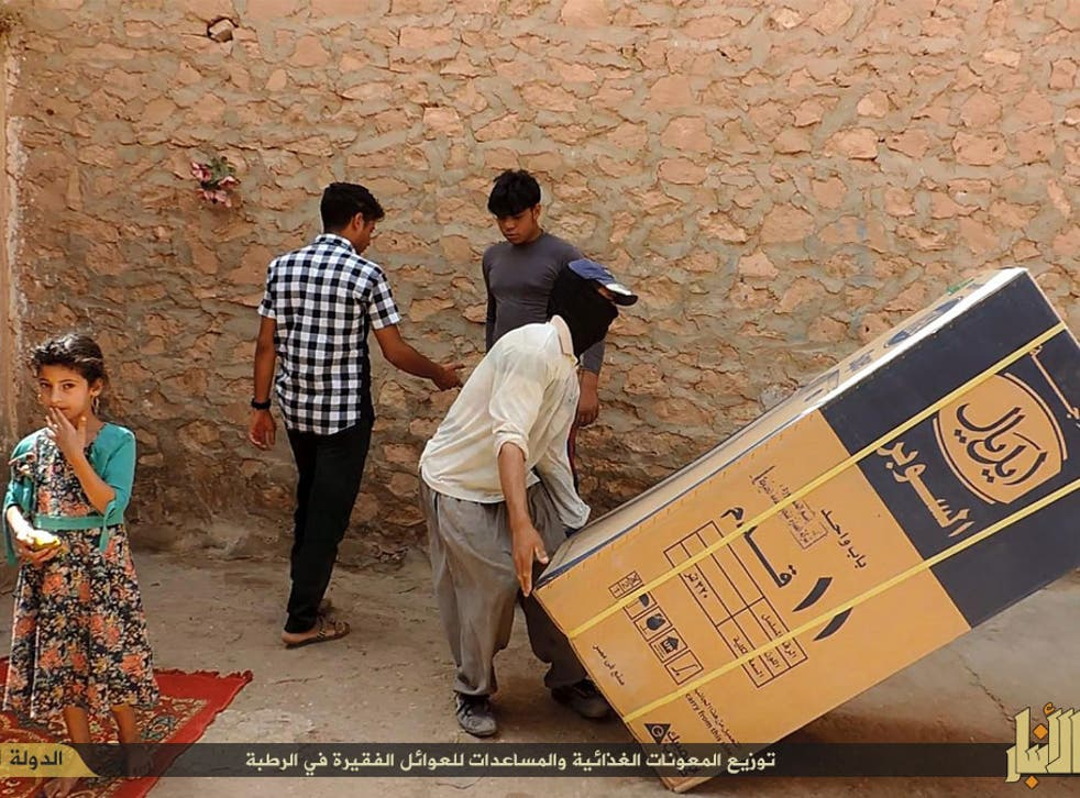 Isis militants claimed to give out fridges in Rutba