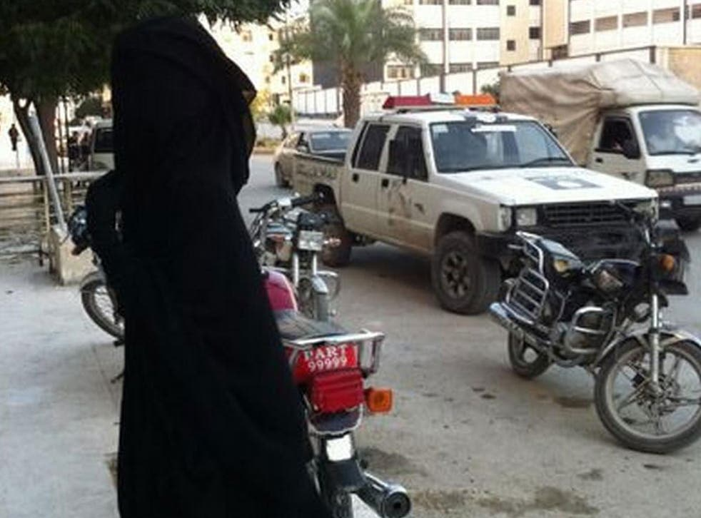 The woman calling herself Al Britaniyaa pictured in Syria
