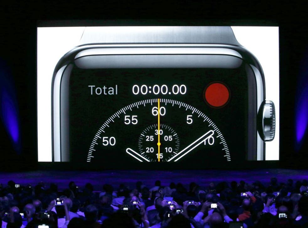 The crowd use their devices to capture the Apple Watch