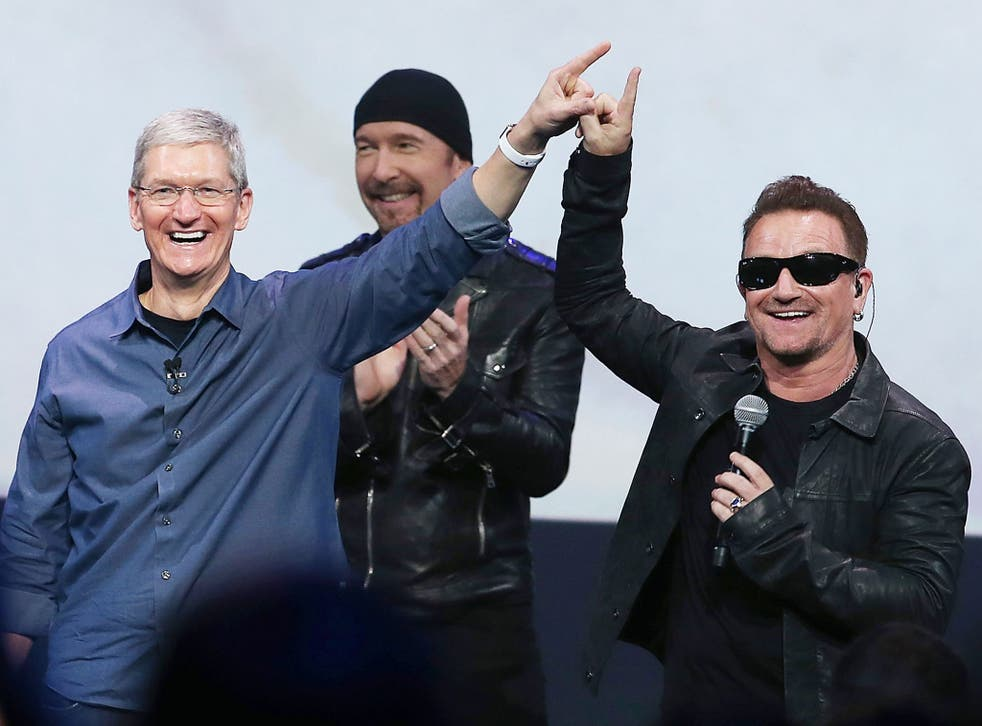 Bono and Apple CEO Tim Cook announce U2's surprise new album at the iPhone 6 launch