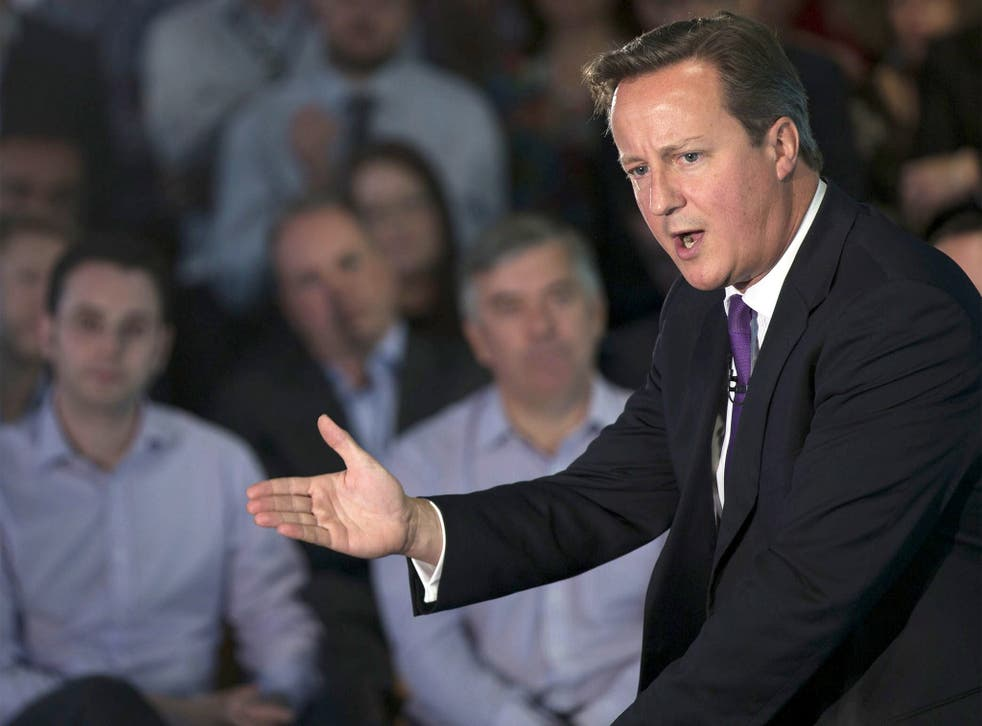 British Prime Minister David Cameron gestures as he speaks during a visit to Scottish Widows offices in Edinburgh