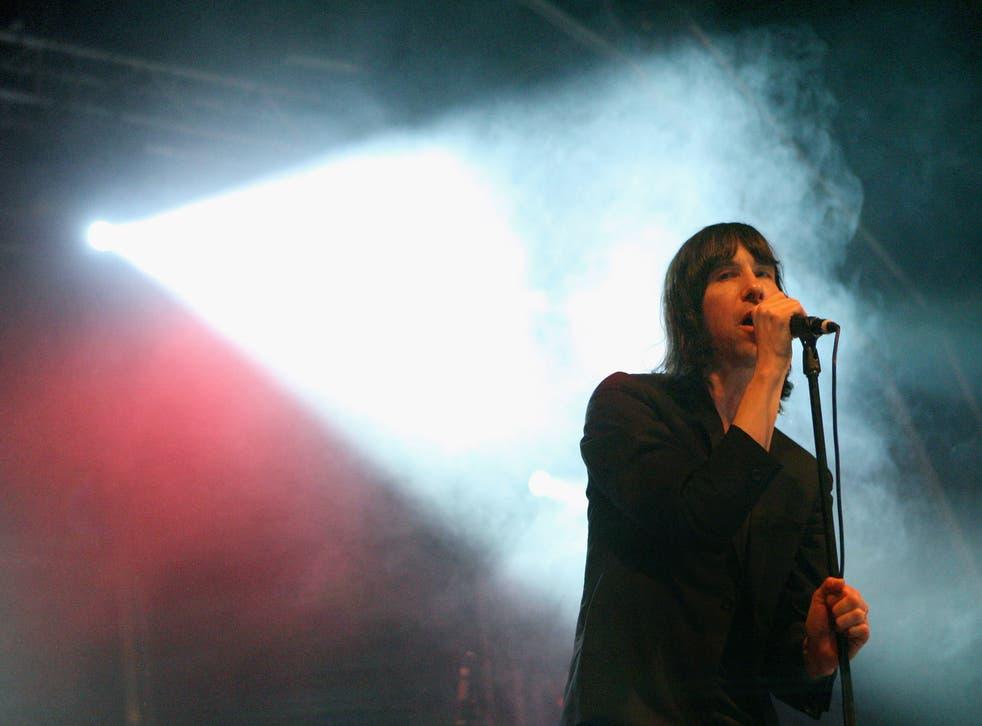 Primal Scream frontman Bobby Gillespie on stage