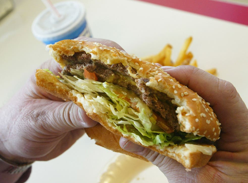 A first-person view of someone eating a hamburger