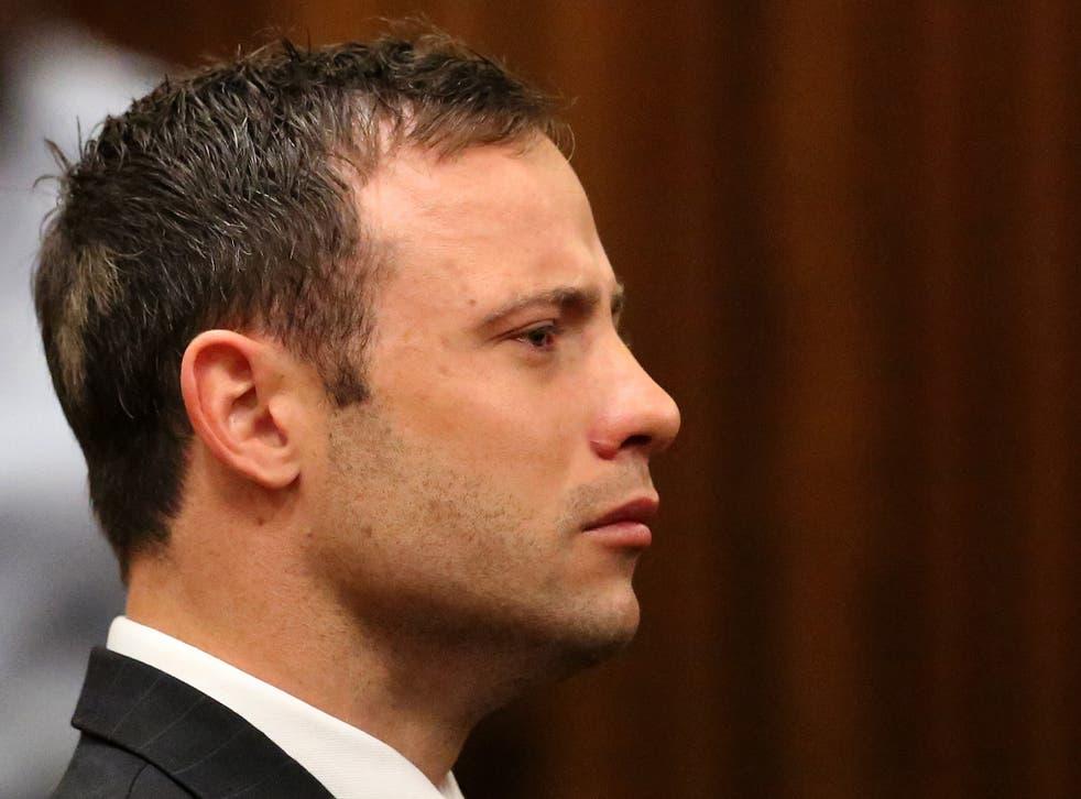 Oscar Pistorius listens to the verdict in his trial at the high court in Pretoria