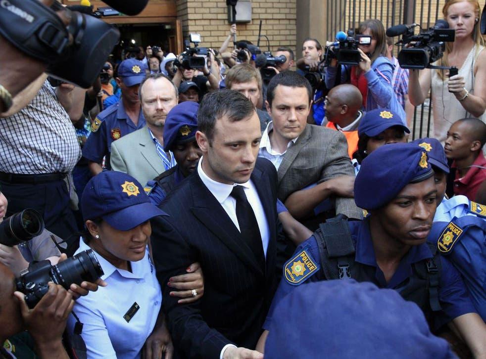 Oscar Pistorius leaving court on bail on 12 September