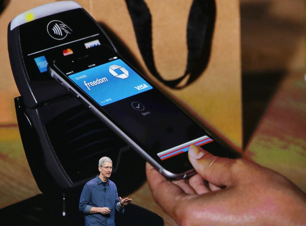 Apple CEO Tim Cook speaks about Apple Pay during the iPhone launch in California.