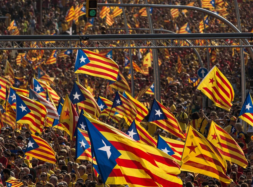 Demonstrators march during a Pro-Independence demonstration as part of the celebrations of the National Day of Catalonia in Barcelona