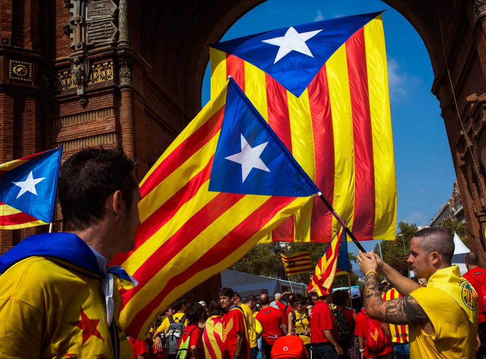 People wave flags, that symbolize Catalonia's independence, in Barcelona