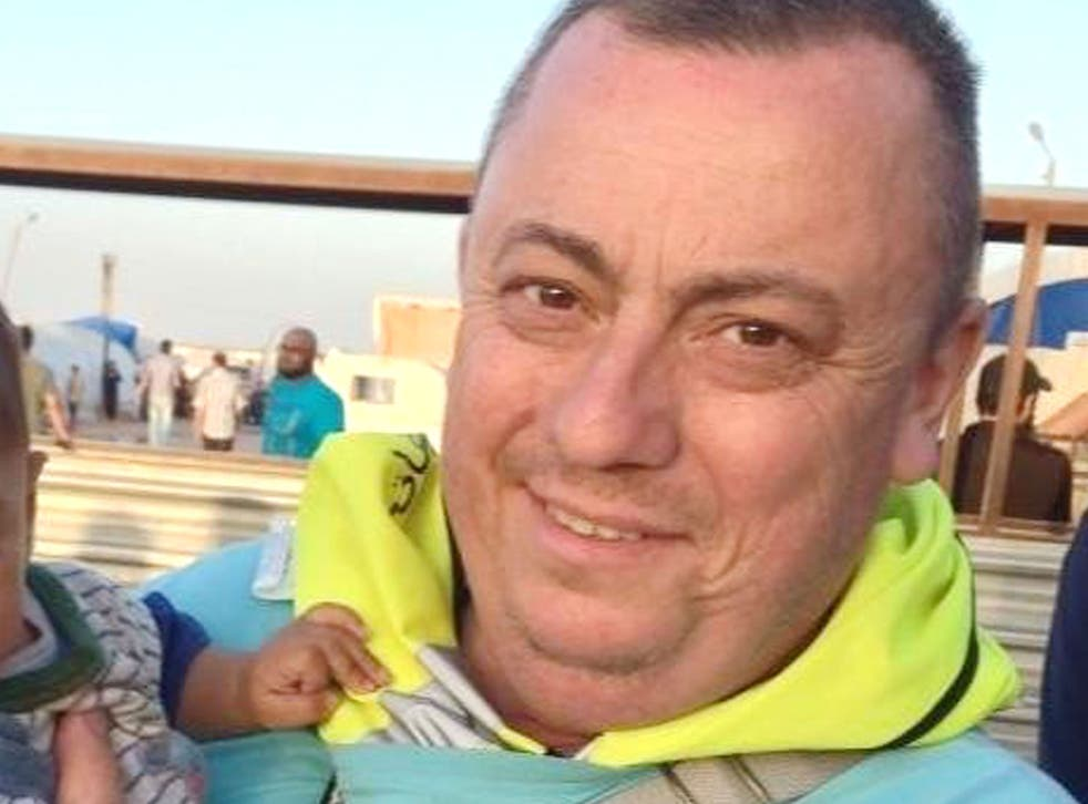 An undated handout photo released by the Foreign Office with the permission of his family, showing Alan Henning at a refugee camp on the Syrian-Turkish border