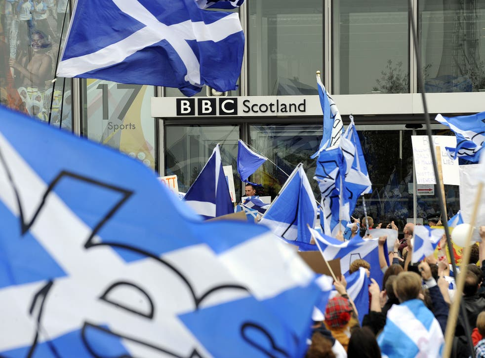 Pro-independence 'Yes' campaigners stage a demonstration outside the BBC Scotland Headquarters in Glasgow on 14 September, 2014