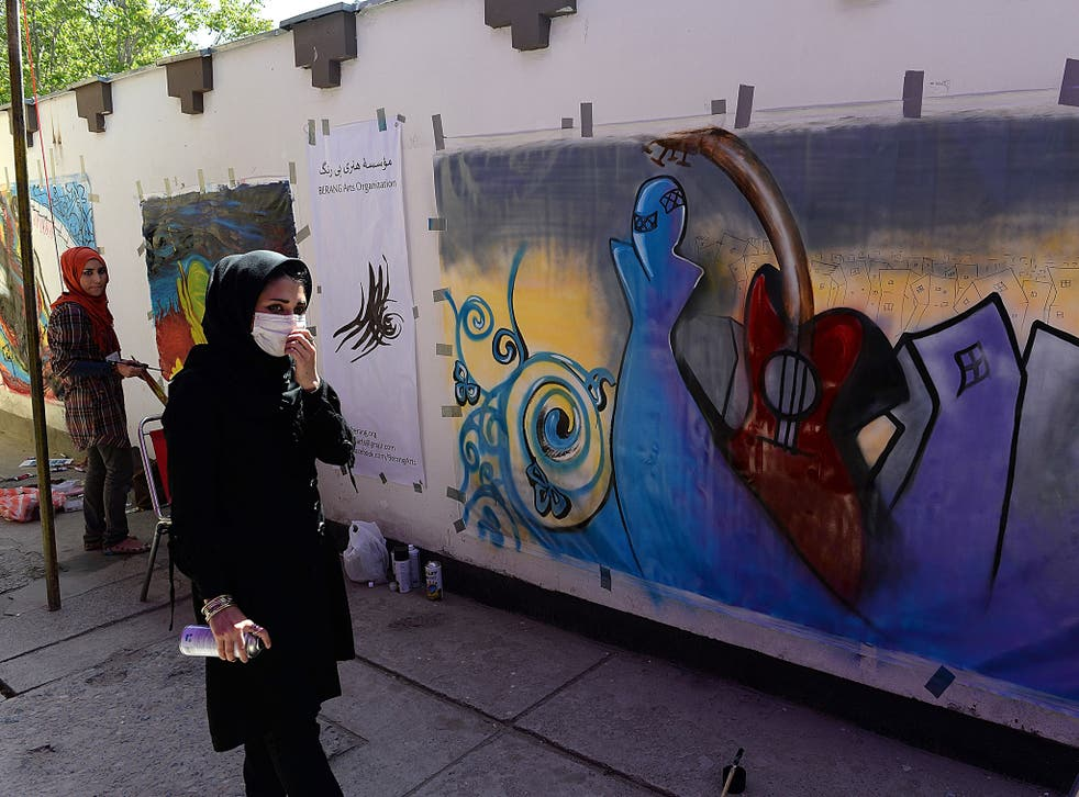 Shamsia Hassani painting one of her works – at the French Cultural Centre in Kabul