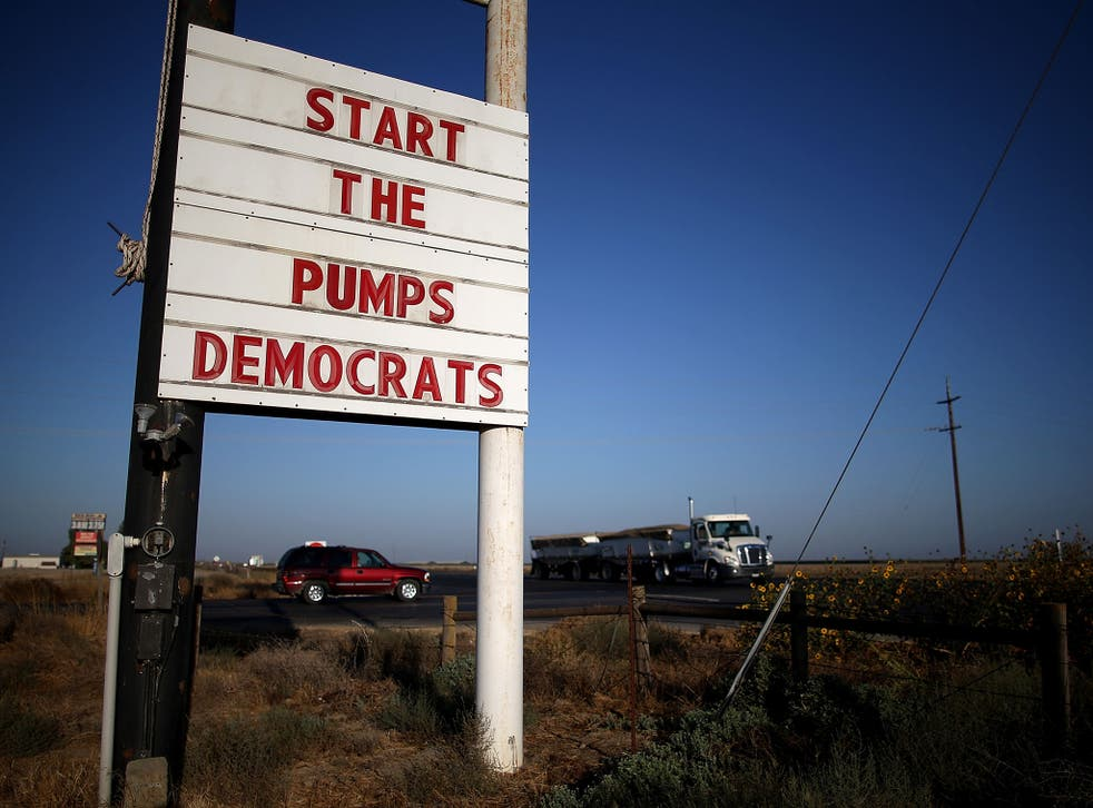 A sign asking politicians to help with the drought in California, where reservoirs are at record low levels and many fields have been left unplanted