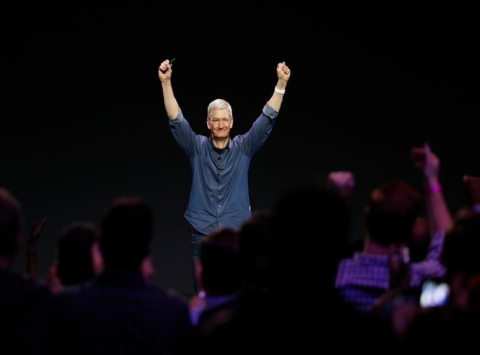 Tim Cook salutes the audience at the unveiling of the iPhone 6 and iPhone 6 Plus at an event in California earlier this month