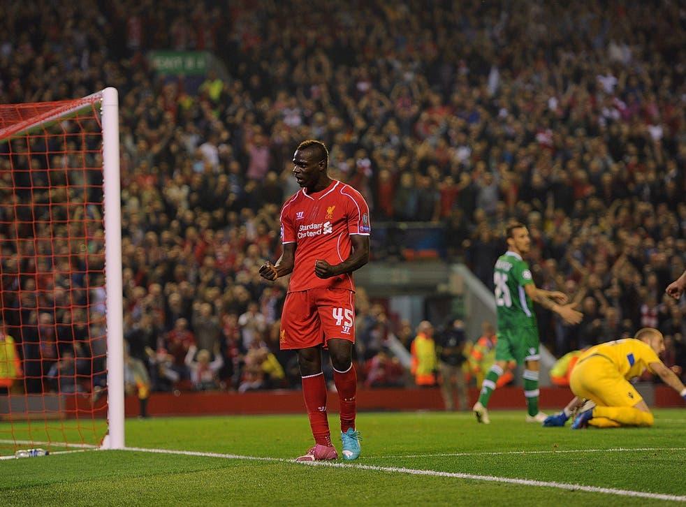 Mario Balotelli celebrates his first Liverpool goal