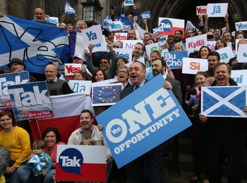 """Scottish First Minister Alex Salmond, front center, meets with Scots and other European citizens to celebrate European citizenship and """"Scotland's continued EU membership with a Yes vote"""" at Parliament Square in Edinburgh, Scotland."""