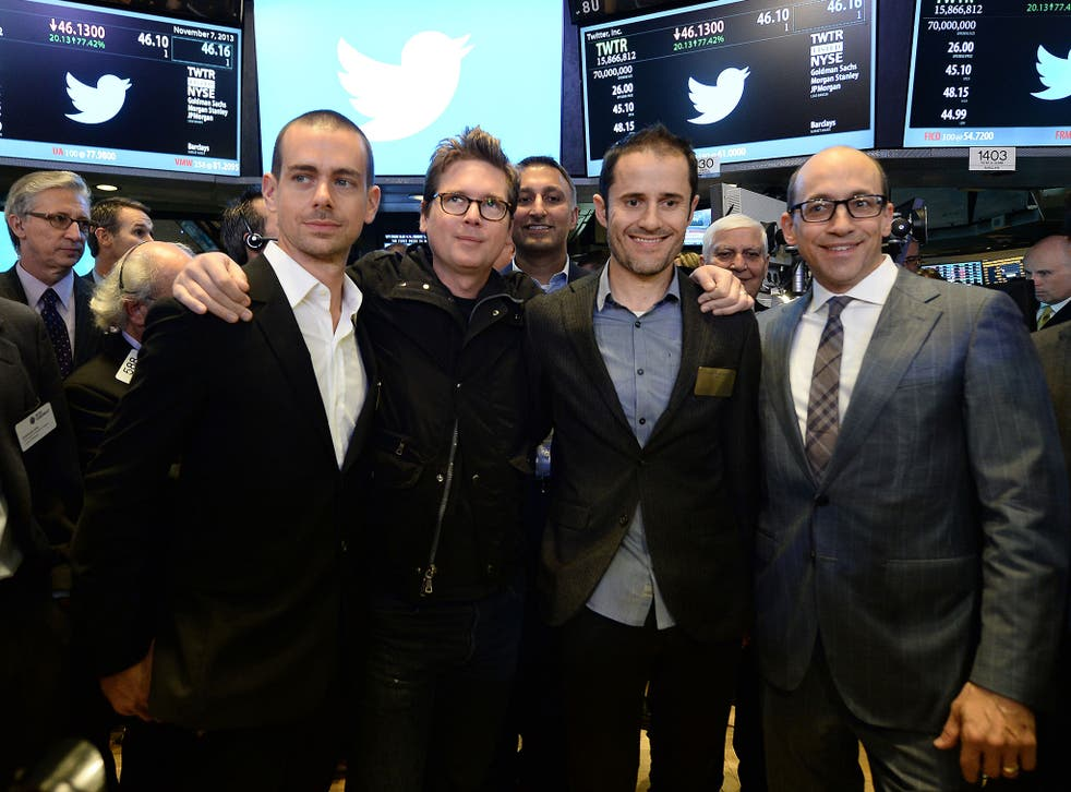 Twitter co-founders Jack Dorsey, Christopher Isaac 'Biz' Stone, Evan Williams and Twitter CEO Richard 'Dick' Costolo pose for a photo on the trading floor of the New York Stock Exchange (NYSE)