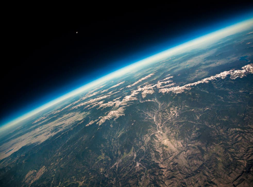 Poised on the brink of space, this astonishing shot shows the curvature of the Earth with the towering Rocky Mountains reduced to tiny wrinkles on the surface below. Taken with the aid of a high altitude balloon, launched from Boulder, Colorado, the photograph captures the breath-taking view of the Earth from 87,000 feet about its surface. The tiny dot of the Moon pictured in the distance emphasizes the vast expanse between our planet and its nearest cosmic neighbour.
