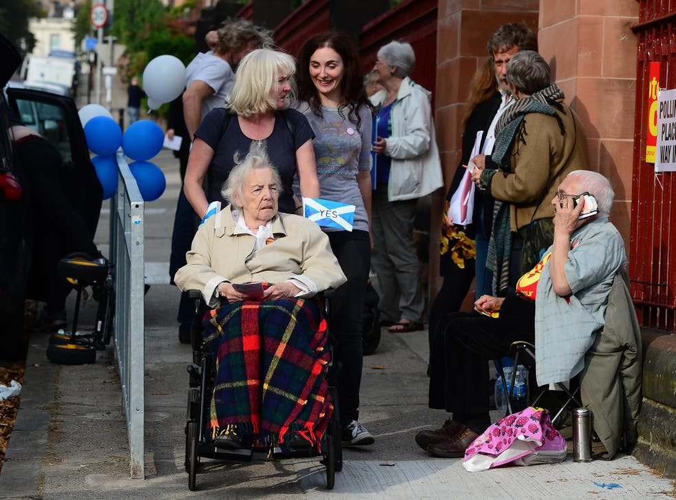 Voters come to Notre Dame Primary School polling station as the people of Scotland take to the polls to decide their country's fate