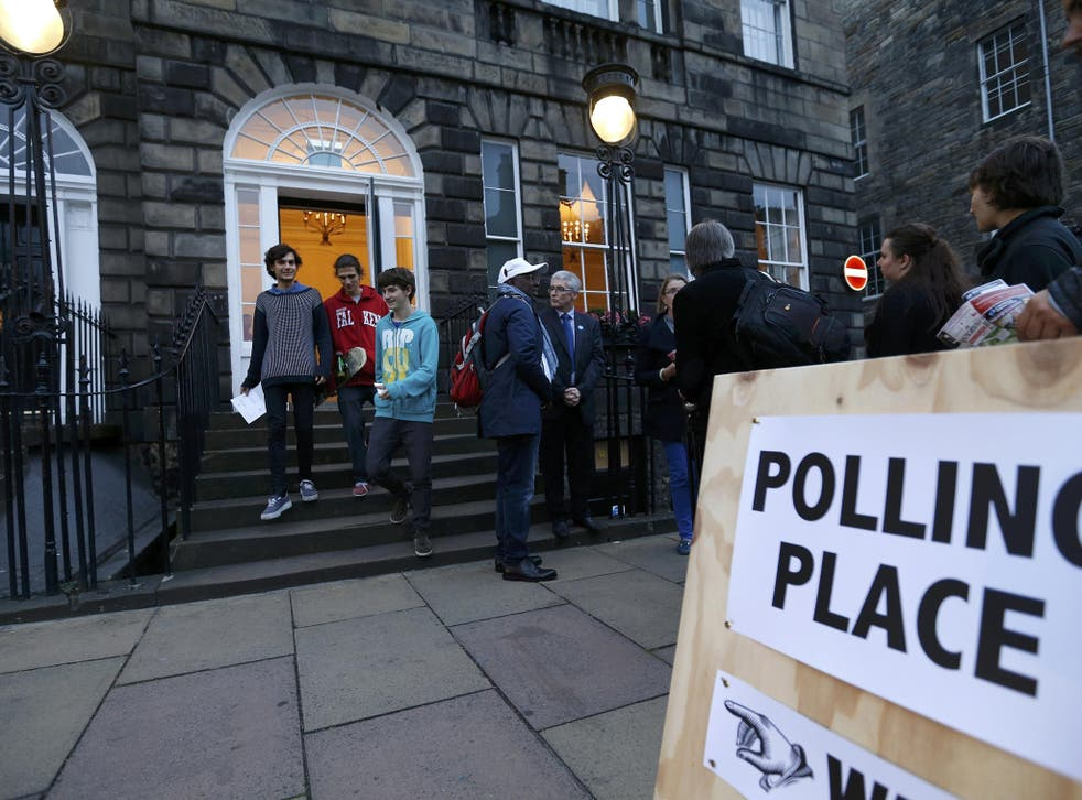 Young voters leave a polling station in Charlotte Square, Edinburgh