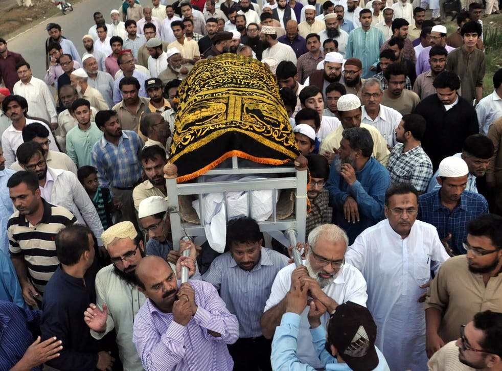 Pakistani people and relatives attending the funeral of Muhammad Shakil Auj, head of Islamic Studies at Karachi University, who was killed by unknown gunmen in restive Karachi, Pakistan