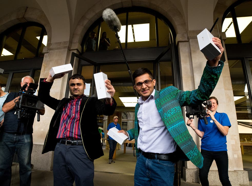 Shoppers in Covent Garden, London, celebrate after they were the first to buy the iPhone 6, released yesterday