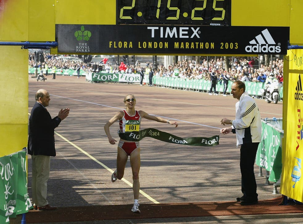 Paula Radcliffe of Great Britain crosses the line to win the 2003 Flora London Marathon