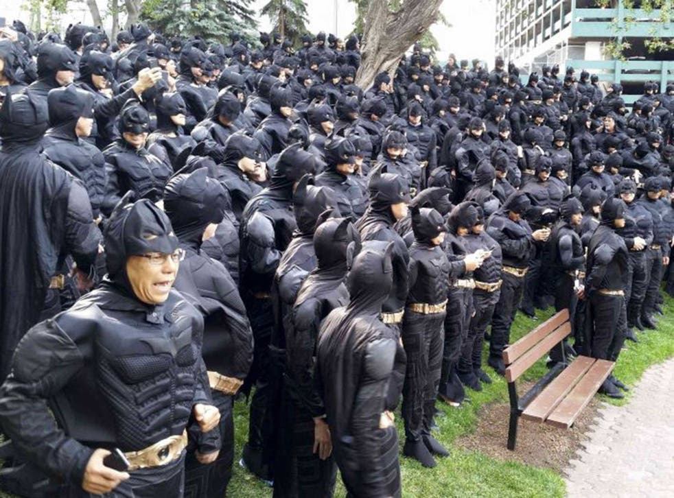 542 employees of the Nexen Energy company gather in a park in Calgary, Alberta