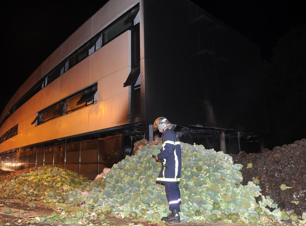 The tax center set fire by angry farmers is seen early September 20, 2014 in Morlaix, western France.