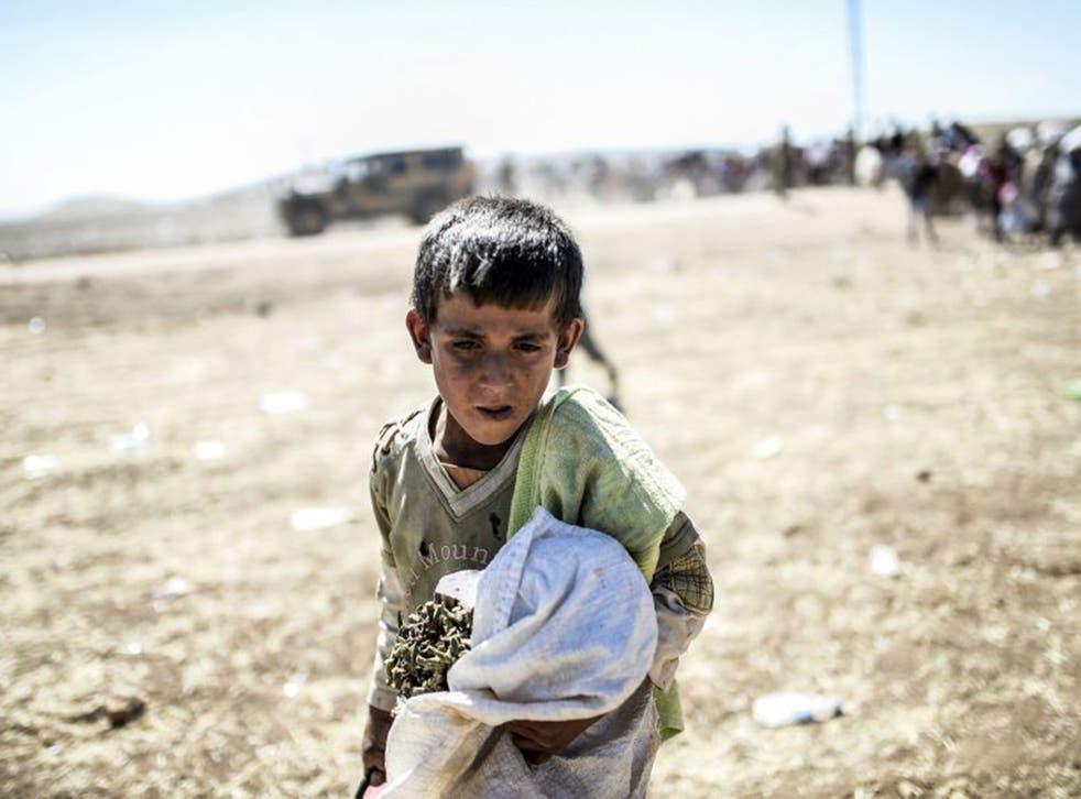 Nowhere child: a Syrian Kurd crosses the border to Turkey