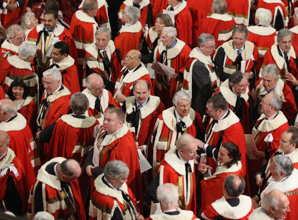 Peers leave the Lords after the state opening of Parliament