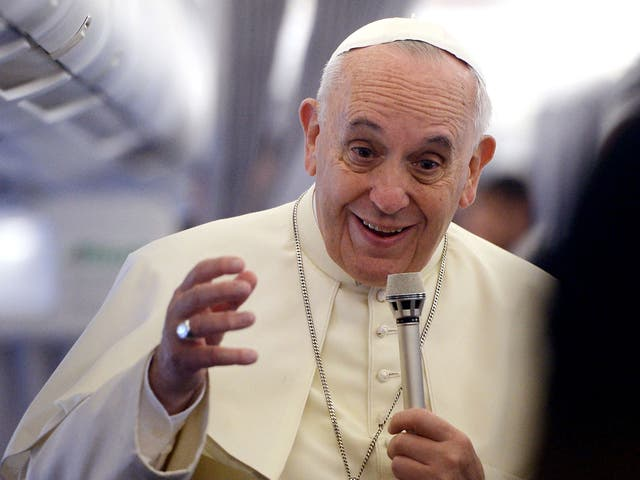 Pope Francis gives a press conference aboard the plane carrying him to Tirana, Albania on 21 September, 2014