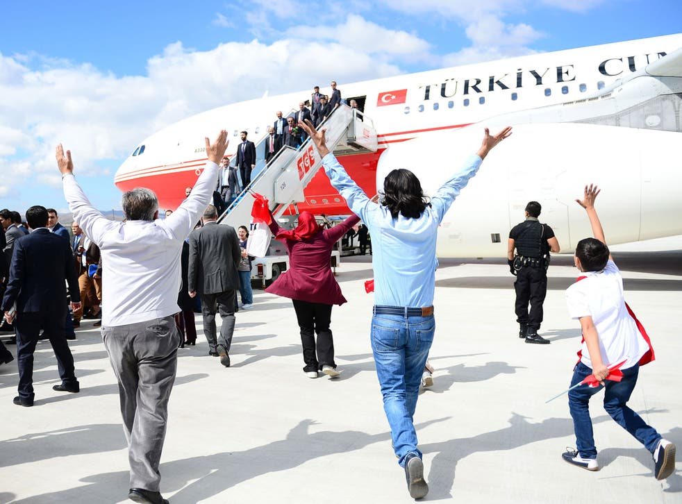 Relatives of the freed hostages greeting their family members in Ankara; questions have been raised about why the brutal organisation chose to release them, unlike other captives