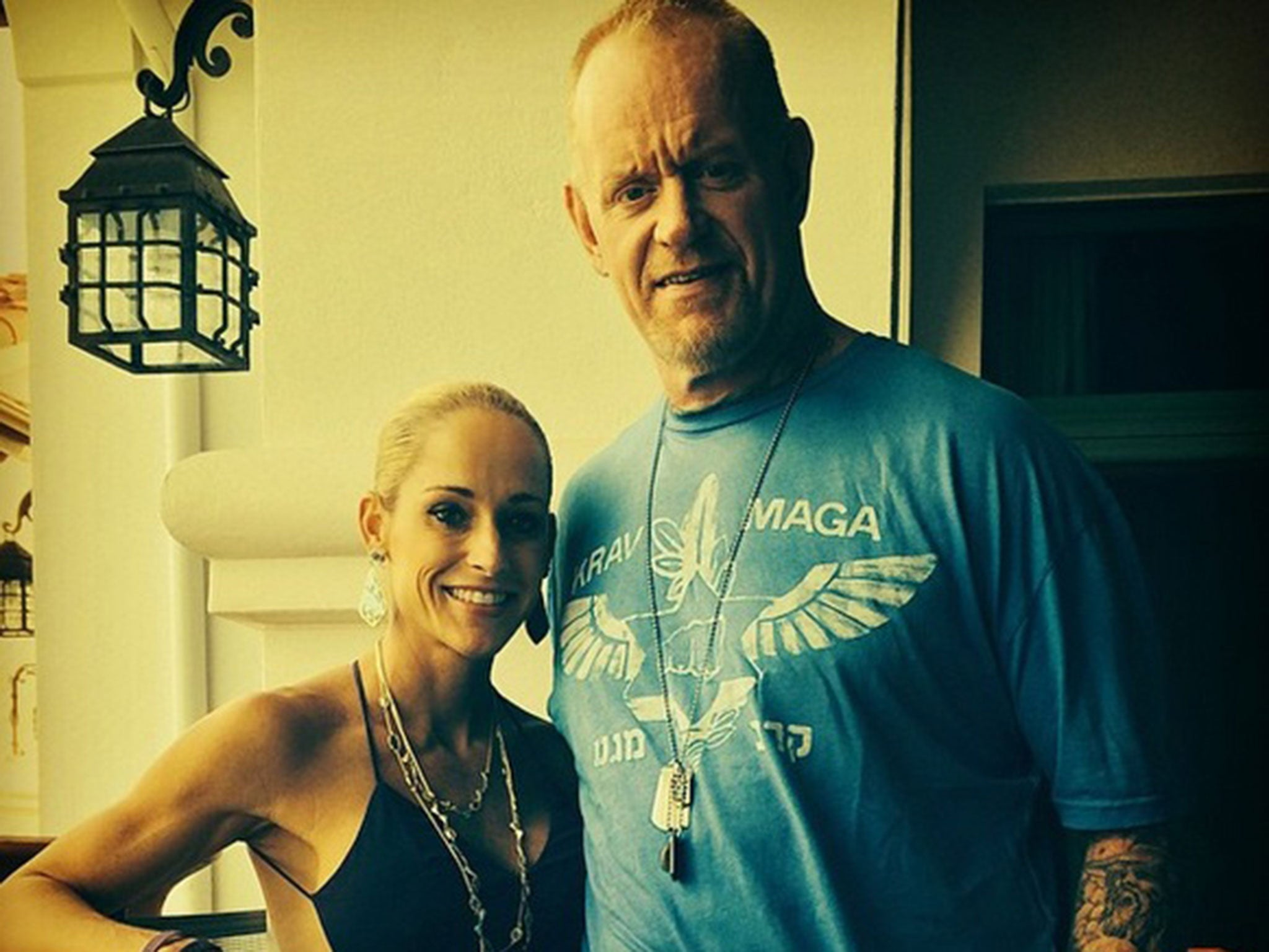 Image result for MICHELLE MCCOOL AND THE UNDERTAKER