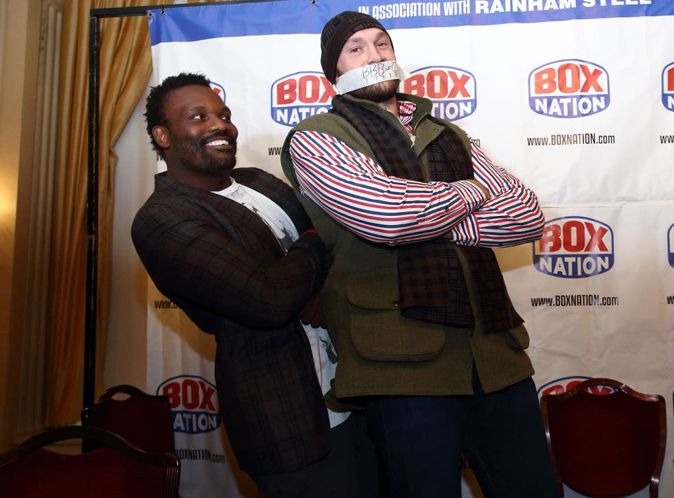 Chisora (left) and Fury at the conference today