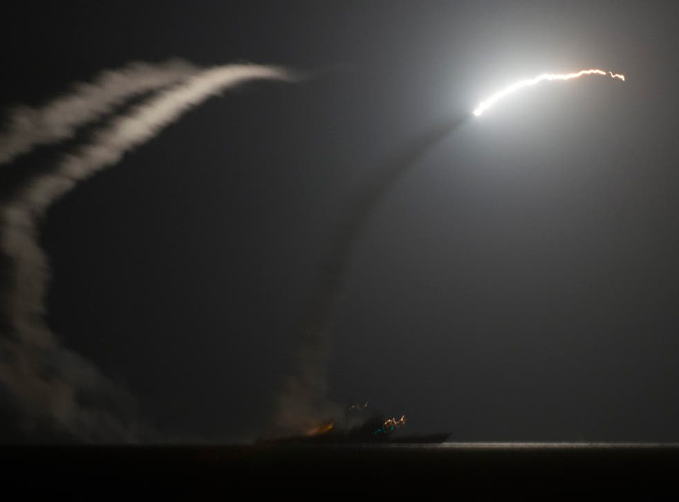 The guided-missile cruiser USS Philippine Sea (CG 58) launching a Tomahawk cruise missile against Isis targets in Syria, as seen from the aircraft carrier USS George H.W. Bush (CVN 77) in the Arabian Gulf